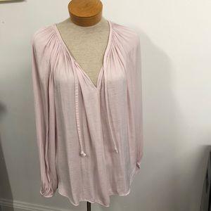 Jennifer Lopez light pink blouse